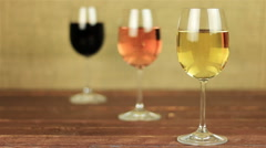 White wine, rose wine and red wine on red table with focus changes Stock Footage