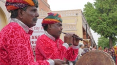 Traditional musicians at Tripolia gate with procession,Jaipur,Gangaur,India Stock Footage