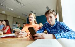 students with smartphone texting at school - stock photo