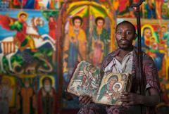 Priest showing an ancient religious book in an Orthodox Monastery, Tigray, - stock photo