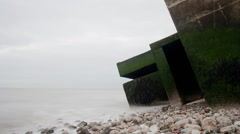 Remains of a concrete second wold war battery post.  Isle of Sheppey Timelapse Stock Footage