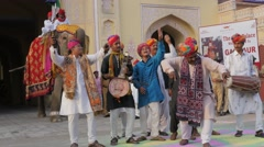 Indian folk musicians in procession with elephant,Jaipur,Gangaur,India Stock Footage