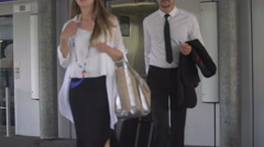 Business trip, man and woman exiting elevator with hand luggage, tourism Stock Footage