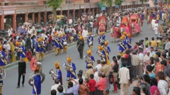 Procession with brass band and bullock carts ,Jaipur,Gangaur,India Stock Footage