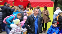 People walk on the national fair Stock Footage