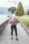 Portrait of woman wearing rabbit mask making peace sign, Lake Como, Italy - stock photo