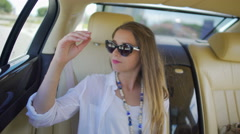 Happy rich girl riding in expensive car, luxury lifestyle, summer vacation Stock Footage