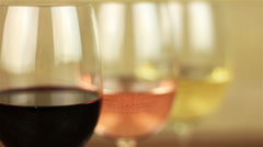 White wine, rose wine and red wine on yellow background with focus changes Stock Footage