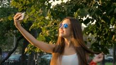 Attractive girl doing selfie smiling Stock Footage