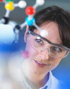 Scientist analysing molecular model in laboratory Stock Photos