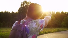 Stylish middle-aged man with longboard having a good time in the park at sunset Stock Footage