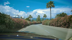 Resort town, view from car on beautiful road, sunny day, driving on vacation Stock Footage