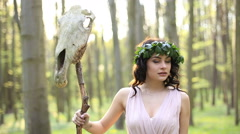 Gorgeous young amazon with long dark hair and skull in the forest Stock Footage