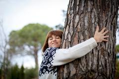 Woman hugging tree Stock Photos