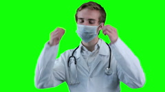 Smiling Doctor removes medical mask looking into screen Stock Footage
