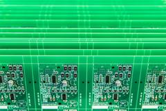 Detail of circuit boards in circuit board assembly factory, close up - stock photo