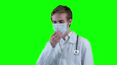 Sad Doctor removes medical mask looking into screen. Green screen, chromakey - stock footage
