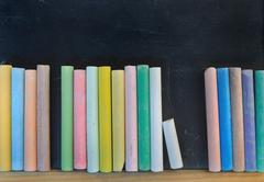 Alignment of colored chalks Stock Photos