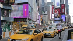 Wide of Times Square New York Daytime Yellow Cabs Stock Footage