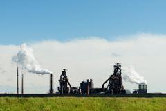 Vapor clouds from foundry, IJmuiden, Noord-Holland, Netherlands - stock photo