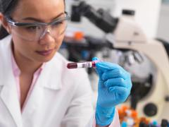 Scientist preparing clinical samples for medical testing in a laboratory - stock photo