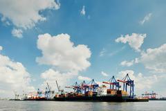 Row of loading cranes on river Elbe, Port of Hamburg, Germany Stock Photos
