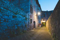 Streetlamp and alley at dusk, Colle di Val d'Elsa, Siena, Italy Stock Photos