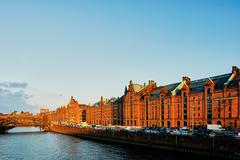 Old warehouses on waterfront at sunset, Hafencity, Hamburg, Germany - stock photo
