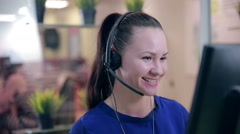 Close-up of smiling woman working in a call center. Customer service Stock Footage