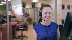 Caucasian woman at a Call center in a bright clean office - stock footage