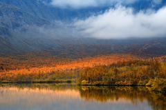Autumn color and low cloud at Maliy Vudjavr Lake, Khibiny mountains, Kola - stock photo
