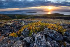 Sunset over Lake Imandra, Khibiny mountains, Kola Peninsula, Russia - stock photo