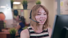 Frendly woman talking on the headset in an office, call centre Stock Footage