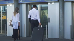 Young couple entering elevator at the airport, business trip, travel and tourism Stock Footage