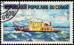 Small motor ship on postage stamp Stock Photos