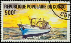 Cargo ship on postage stamp Stock Photos
