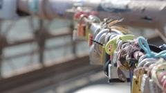 Close up of love locks on Brooklyn Bridge Stock Footage