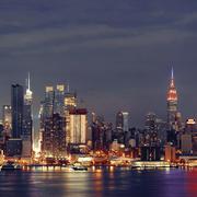 Manhattan midtown skyline at night Stock Photos