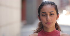 Young woman in city serious face portrait Stock Footage