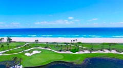Aerial - Beautiful view of Golf Course next to ocean flying back on golf cour Stock Footage