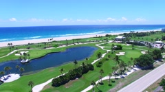 Aerial - Pan Beautiful view of Golf Course next to ocean  Stock Footage