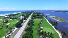 Aerial - Beautiful view of Golf Course next to ocean - Panoramic. Stock Footage