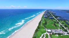 Aerial - Beautiful static view of Golf Course next to ocean  Stock Footage