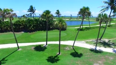 Aerial - Beautiful view of Golf Course next to ocean going up Stock Footage