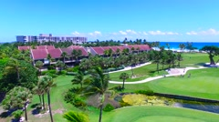 Aerial - Beautiful view of Golf Course and resort next to ocean  Stock Footage