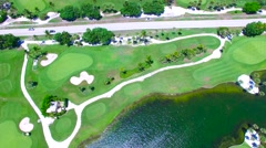 Aerial - Beautiful view of Golf Course next to ocean with road in the middle. Stock Footage