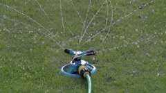 Slow Motion Garden Sprinkler Stock Footage