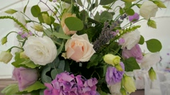 Wedding party flowers sliding camera white and violet bouquet Stock Footage