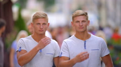 The handsome twin make a hairstyle on the head. Real time capture Stock Footage