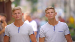 The handsome twin look and standing in the crowd. Real time capture Stock Footage